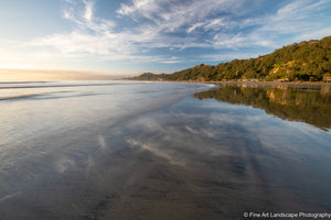 Clouds reflecting on the wet sand at West End, Ohope Beach