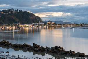 Lights reflecting on the Whakatane River at dusk