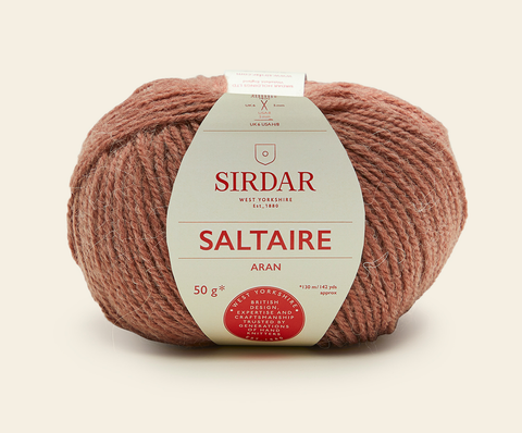 A ball of Saltaire Aran yarn in the colourway Squirrel - a dusty pink/brown