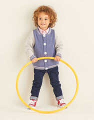 Boy holding hula hoop wearing a baseball jacket hand-knitted from Sirdar Replay yarn