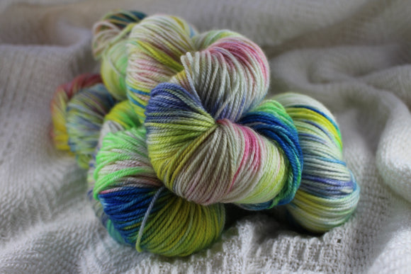 Skein of colourful hand dyed yarn by Crates of Wool