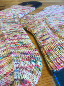 Hand knitted socks on blockers showing toe and heel construction