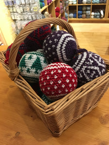 Colourful christmas baubles in a basket crocheted using tapestry crochet as taught at Crates of Wool
