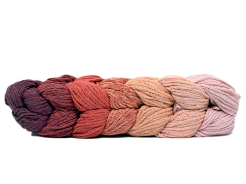 A chain of Mondial Treccia yarn showing the graded colours