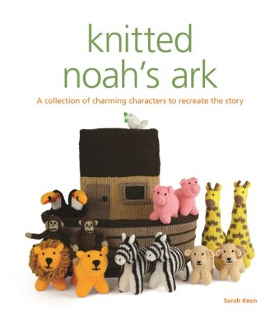 "The front cover of ""knitted noah's ark"" by Sarah Keen, with the tagline ""A collection of charming characters to recreate the story"". There is an image of knitted animals aboard the knitted ark, including toucans, lions, zebras, pigs, and giraffes."