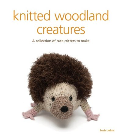 "The front cover of ""knitted woodland critters"" by Susie Johns, with the tagline ""A collection of cute critters to make"", with an image of a knitted hedgehog."
