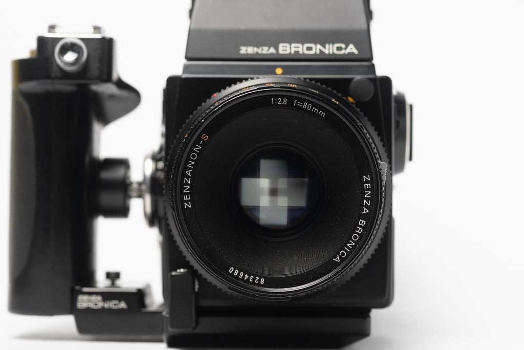 Front of Bronica SQ-A Medium Format Film Camera with 80mm 2.8 Lens, Speed Grip, and Metered Prism Viewfinder
