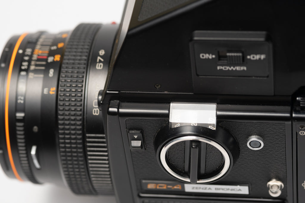 Side of viewfinder of Bronica SQ-A Medium Format Film Camera with 80mm 2.8 Lens, Speed Grip, and Metered Prism Viewfinder