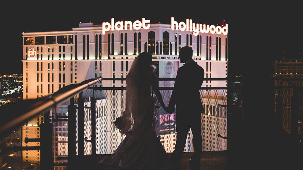 Wedding couple at the on the balcony at the Cosmopolitan Hotel in Las Vegas.