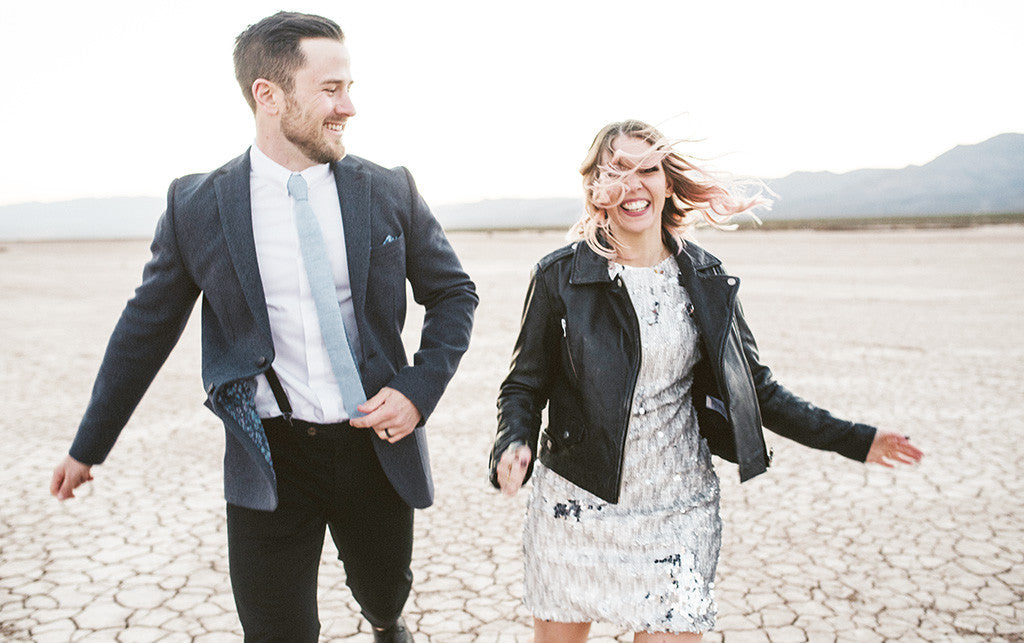 Picture of an English couple running in the desert that got married in Las Vegas
