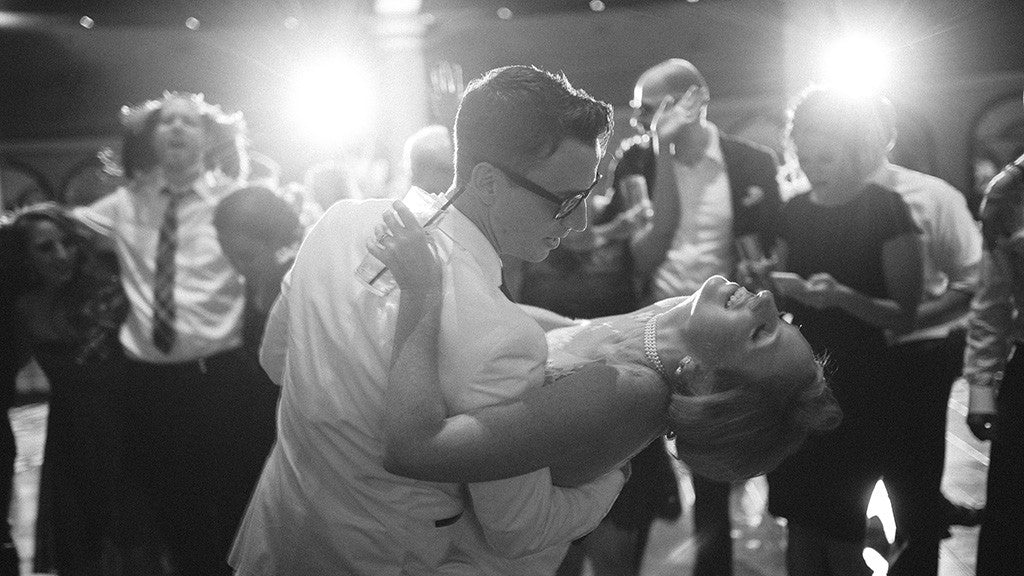 A groom dipping a bride at a wedding reception at the JW Marriott in Las Vegas