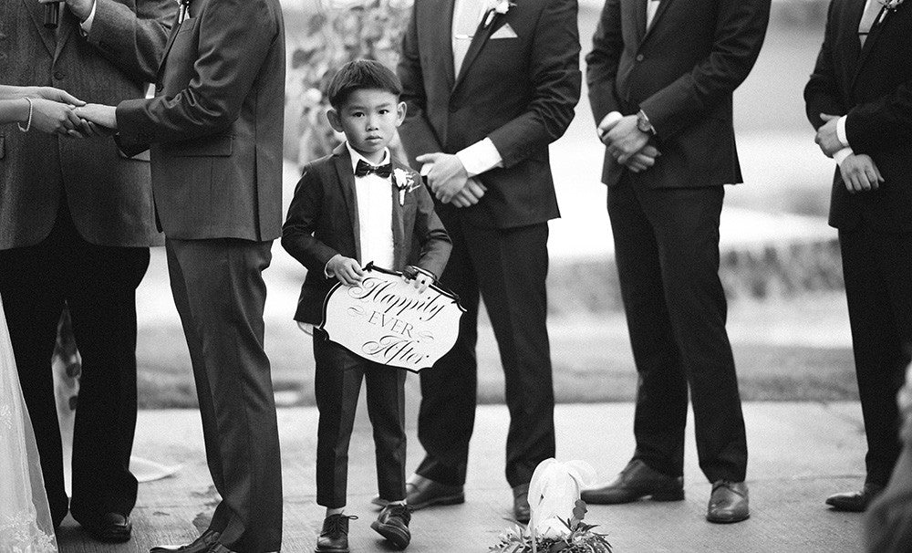 A Ring Bearer with a sign at a Spanish Trails Wedding in Las Vegas