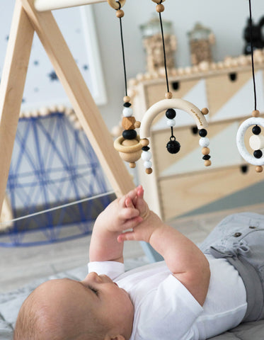 wooden baby gym gritty