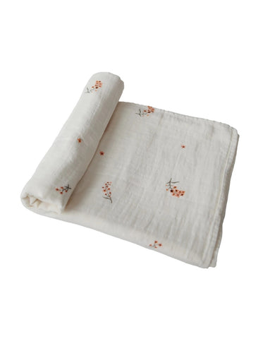 mushie organic cotton swaddle blanket flowers