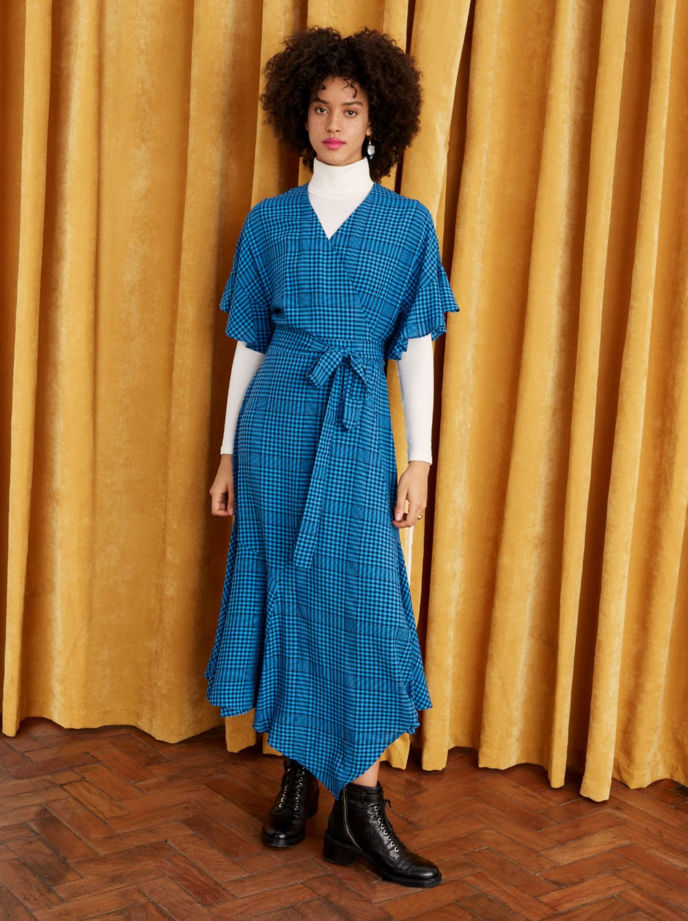 Kitri blue wrap dress available to rent - full body front view on model