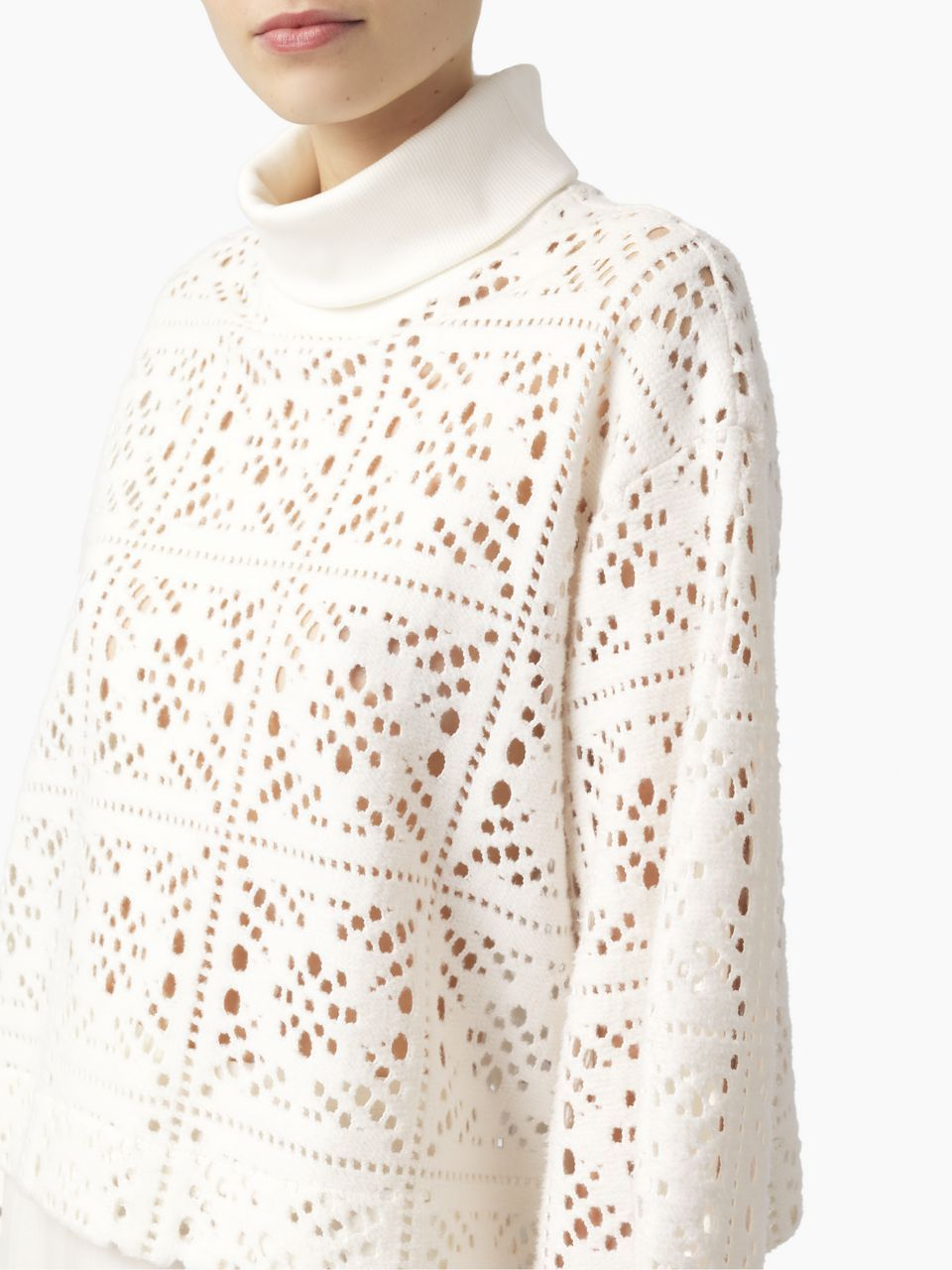 Laser cut flared-sleeve top