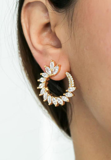 Golden earrings for bride with white stones
