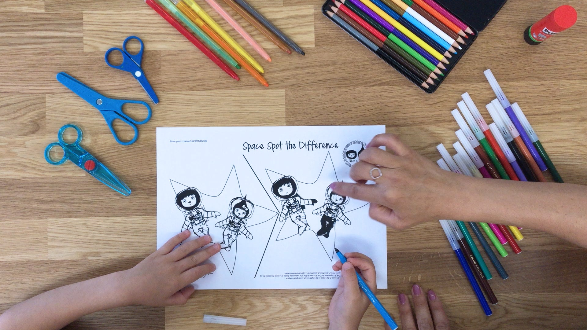 child and parent colouring in spot the difference activity page | Zip and Zoe activity book