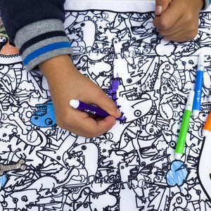 Zip and Zoe by Babymel colour & wash art canvas multi, kid holding washable pens and colouring in art canvas | colour in table cloth | kids colouring