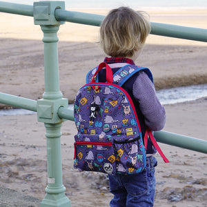 Zip and Zoe by Babymel Kid's backpack age 3+ monster, boy wearing backpack on beach | school bags for boys | boys backpack | school bags for girls | backpacks for girls | kids school bags | kids backpacks