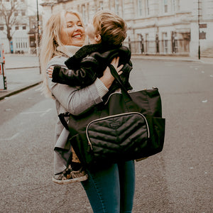 BABYMEL AMBER BLACK | CHANGING BAG | MUM HOLDING BAG AND CHILD