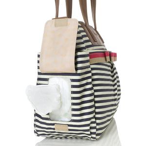 Babymel changing bag Cara stripe navy, side view showing baby wipes coming out of the pocket,, printed stripe changing bag, handbag, shoulder bag.