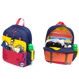 Zip and Zoe by Babymel Junior backpack navy colour block, front pocket and main compartment open and filled with books, pencil case, snacks and water bottle  | school bags for boys | boys backpack | school bags for girls | backpacks for girls | kids school bags | kids backpacks