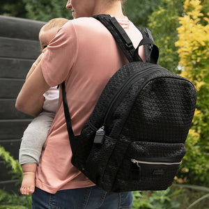 Babymel changing bag, Luna Scuba Black ultra-lite, mum wearing backpack holding baby, black neoprene backpack, rucksack baby bag
