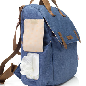 Babymel convertible changing bag , Robyn Mid blue, side view showing wipes dispenser pocket, backpack changing bag, rucksack bag baby bag