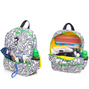 Zip and Zoe by Babymel Junior backpack dino black & white,  front pocket and main compartment open and filled with books, pencil case, snacks and water bottle | dinosaur backpack | school bags for boys | boys backpack | school bags for girls | backpacks for girls | kids school bags | kids backpacks
