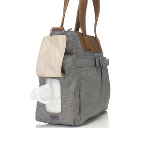 Babymel changing bag Cara grey, side view showing baby wipes coming out of side pocket,, grey melange changing bag, handbag, shoulder bag.