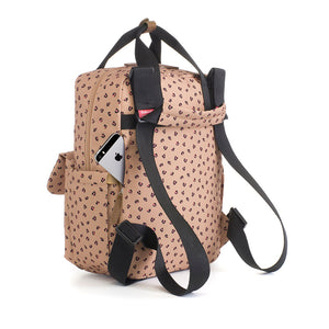 Babymel eco changing bag convertible backpack, Georgi Caramel Leopard, back view showing backpack straps and concealed phone pocket, recycled material, animal print changing bag