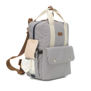 Babymel eco changing bag convertible backpack, Georgi navy stripe, side view showing baby wipes pocket, recycled material, striped print changing bag