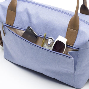 Babymel changing bag, Jade Bluebell, back view showing parent items in pocket, blue melange, handbag baby bag