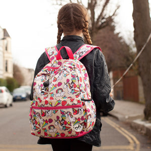 Zip and Zoe by Babymel Junior backpack unicorn, girl on street wearing backpack and holding a ballon | unicorn backpack | school bags for girls | backpacks for girls | kids school bags | kids backpacks