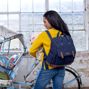 Babymel convertible changing bag , Robyn navy, mum wearing backpack, unisex backpack changing bag, rucksack bag baby bag