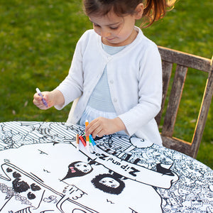 Zip and Zoe by Babymel colour & wash art canvas multi, girl holding washable pens and colouring in art canvas in garden | colour in table cloth | kids colouring
