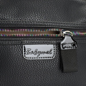 Babymel changing bag, Luna vegan leather black, close up showing grainy leather and multicoloured zip, black PU faux leather backpack, rucksack baby bag