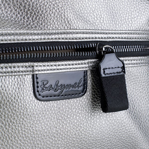Babymel changing bag, Luna vegan leather pewter, close up showing grainy faux leather and gunmetal zip, metallic PU faux leather backpack, rucksack baby bag