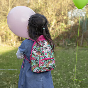Zip and Zoe by Babymel mini backpack & safety harness-reins flamingo, girl wearing backpack and holding balloon in park | toddler backpack with reins | toddler rucksack | backpacks for girls | kids school bags | kids backpacks