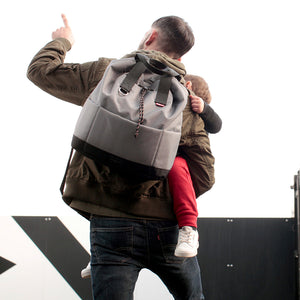 Babymel Changing bag backpack, top 'n' tail eco grey, recycled material,  drawstring rucksack, dad wearing backpack and holding child