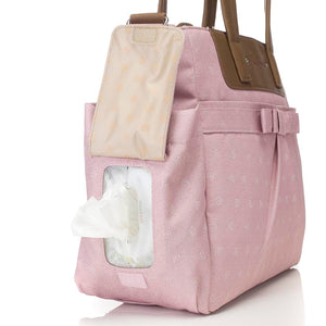 Babymel changing bag Cara dusty pink origami heart, side view showing baby wipes coming out of pocket side , baby pink changing bag, handbag.