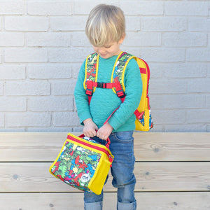 Zip and Zoe by Babymel zipped lunchie and ice pack dino multi, boy wearing backpack and holding lunch bag | lunch bag | boys lunch bag | girls lunch bag | ice pack