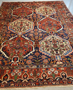 Tribal Made Bakhtiari Rug with Rich Saffrom