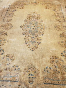Bottom right view of wool Kirman area rug