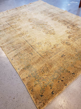Load image into Gallery viewer, Light side or top view right side of a kirman hand-knotted rug  with medallion colors are very muted and lots of patina