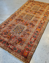 Load image into Gallery viewer, This is a top left side angled view of the Qashqai HandKnotted Area Rug