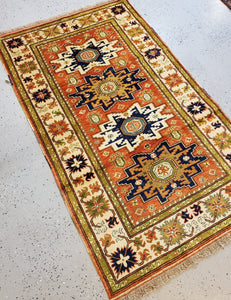 full view of this Turkish made Caucasion rug from top right or lighter side of the rug