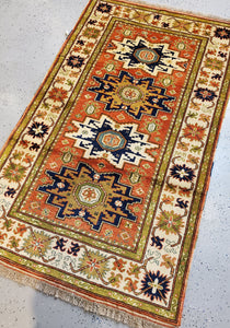 full view of this Handknotted rug from top left or lighter side of the carpet