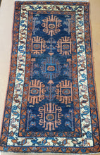 Load image into Gallery viewer, a hand knotted rug runner with 3 borders and Blue field Floral and geometric shapes
